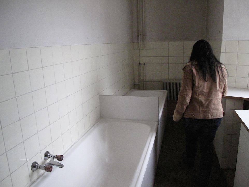 CHRISTINE J., on first visiting the bathroom in the cloister where she had been repeatedly tortured and raped by Catholic nuns. Martinsbühel near Innsbruck, Austria (April 14, 2012)